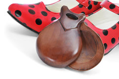 Spanish castanets and typical dot-patterned red flamenco shoes Royalty Free Stock Photo
