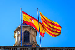 Spanish and Catalan flag. Flying on a historic building in Barcelona, Spain Royalty Free Stock Photography