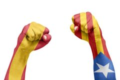 Spanish and Catalan flag painted in the hand with a fist. Refere. Ndum. Isolated white background Stock Photography
