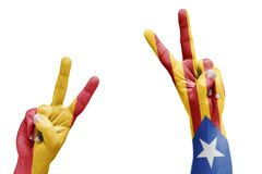 Spanish and Catalan flag painted on hands celebrating victory, r Stock Image