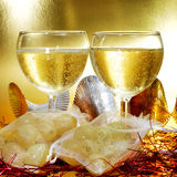 Spanish champagne and the twelve grapes of luck. Some glasses with spanish champagne and sachets with the twelve grapes of luck, traditional on the New Year Stock Photo