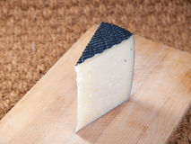 Spanish cheese on a wooden board Royalty Free Stock Photo