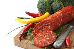 Spanish chorizo sausage with chili peppers and broccoli Royalty Free Stock Photos
