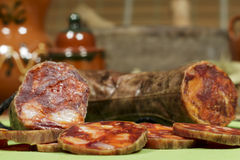 Spanish chorizo slices made of iberian pork. Gourmet product. Stock Images