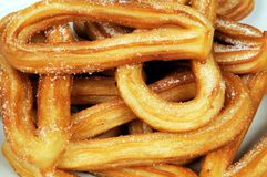 Spanish churros. Deep fried Spanish sweet churros spinkled with sugar, Spain Stock Photography