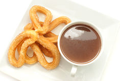Spanish churros with hot chocolate Royalty Free Stock Photo