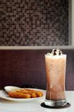 Spanish Churros with vanilla float icecream on dark frozen mocha Royalty Free Stock Photo