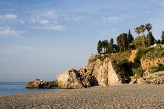 Spanish Cliff. Rocky cliff and beach on the costa del sol stock photos