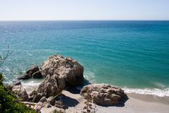 Spanish Coastline. Rocks and beach on the costa del sol stock images