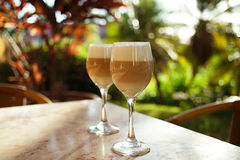 Spanish coffee latte in tall glasses with morning sunny backgrou Stock Photos