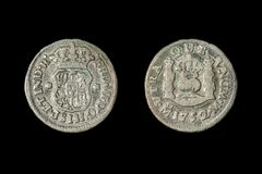 A 1752 Spanish half real coin, called a `picayune` in the United States. Isolated on black royalty free stock photos