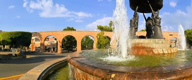 Spanish colonial aquaeduct in Morelia, Central. Fountain with Spanish colonial aquaeduct providing water in former silver mining town of Morelia, Central Mexico Stock Photo