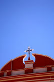 Spanish colonial architecture. Metal cross on red church called Nuestra Senora De La Candelaria in the city of Tupiza , Bolivia Stock Photography