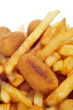 Spanish combo platter with croquettes, calamares and french fries. Closeup of a spanish combo platter with croquettes, calamares and french fries stock images