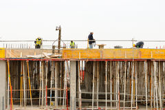 Spanish construction worker, construct a major build Royalty Free Stock Photos