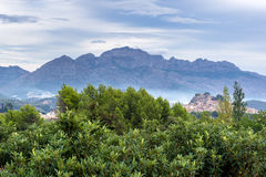 Spanish countryside. With olive trees, typical Spanish village and the mountains in the background stock photos