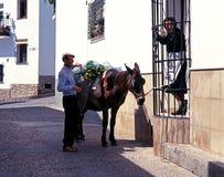 Spanish couple and donkey, Jimena de la Frontera. Royalty Free Stock Images