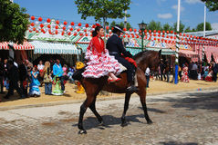 Spanish couple on a horse. Royalty Free Stock Image