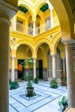 Spanish courtyard. A Spanish style courtyard as seen in Seville Spain Stock Photos