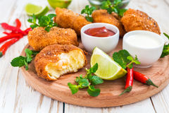 Spanish croquetas croquettes with shrimp, mint and chilly. Traditional fried Spanish croquetas croquettes with shrimp, mint and chilly, ketchup and mayonaise on royalty free stock photos