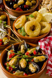 Spanish Cuisine. Assorted tapas on ceramic plates. Stock Photo