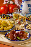 Spanish Cuisine. Assorted tapas on ceramic plates. Stock Photography