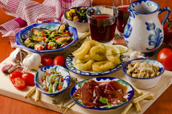 Spanish Cuisine. Assorted tapas on ceramic plates. Stock Image