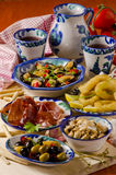 Spanish Cuisine. Assorted tapas on ceramic plates. Royalty Free Stock Image