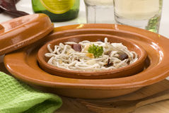 Spanish cuisine. Baby eels in garlic sauce. Stock Image
