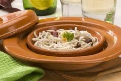 Spanish cuisine. Baby eels in garlic sauce. Stock Image