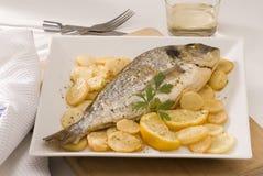 Spanish cuisine. Baked gilthead. Royalty Free Stock Photos