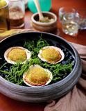 Spanish cuisine baked scallops served as tapas Stock Photo