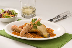 Spanish cuisine. Chicken and langoustines. Royalty Free Stock Photography