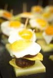 Spanish cuisine egg tapas dishes in restaurant Stock Photos
