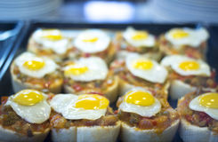 Spanish cuisine egg tapas dishes in restaurant Royalty Free Stock Images