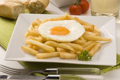 Spanish cuisine. Fried eggs with potatoes. Royalty Free Stock Images