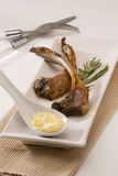 Spanish cuisine. Grilled lamb spares. Spanish cuisine. Grilled lamb spares served with galic mayonnaise sauce. Costillas de cordero Royalty Free Stock Image