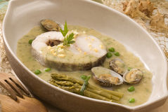 Spanish cuisine. Hake Basque style. Stock Photos