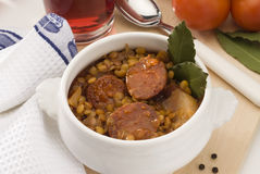 Spanish cuisine. Lentils with red sausage. Royalty Free Stock Photography