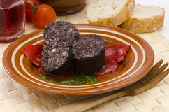 Spanish Cuisine. Morcilla de Burgos. Black Pudding. Spanish Tapas. Blood and rice sausage, Burgos Style, served  in a ceramic dish. Morcilla de Burgos Stock Images