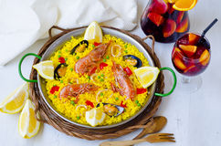 Spanish Cuisine. Paella and fresh sangria. Royalty Free Stock Photography