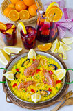 Spanish Cuisine. Paella and fresh sangria. Stock Photo