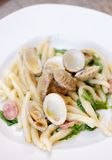 Spanish cuisine. Pasta with Clams and Chorizo Royalty Free Stock Image