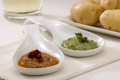 Spanish cuisine. Red and green mojo sauce. Royalty Free Stock Photography