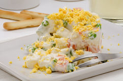 Spanish Cuisine. Russian salad. Ensaladilla rusa. Spanish Tapas. Russian salad in a white plate. Ensaladilla rusa. Selective focus Stock Photo
