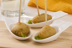 Spanish cuisine. Salt cod fritters. Stock Photos
