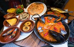 Spanish cuisine, tapas and seafood paella Stock Photography