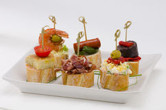 Spanish Cuisine. Tapas. Tray of montaditos. royalty free stock images