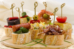 Spanish Cuisine. Tapas. Tray of montaditos. Stock Photos
