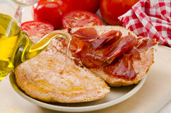 Spanish Cuisine. Tomato bread and Serrano Ham. Pa amb tomaquet i Stock Photography